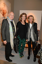 Left to right, ROLF SACHS, MARYAM SACHS and PRINCESS CHANTAL OF HANOVER at the PAD Art and Design Fair 2013 Collectors Preview in Berkeley Square, London on 14th October 2013.