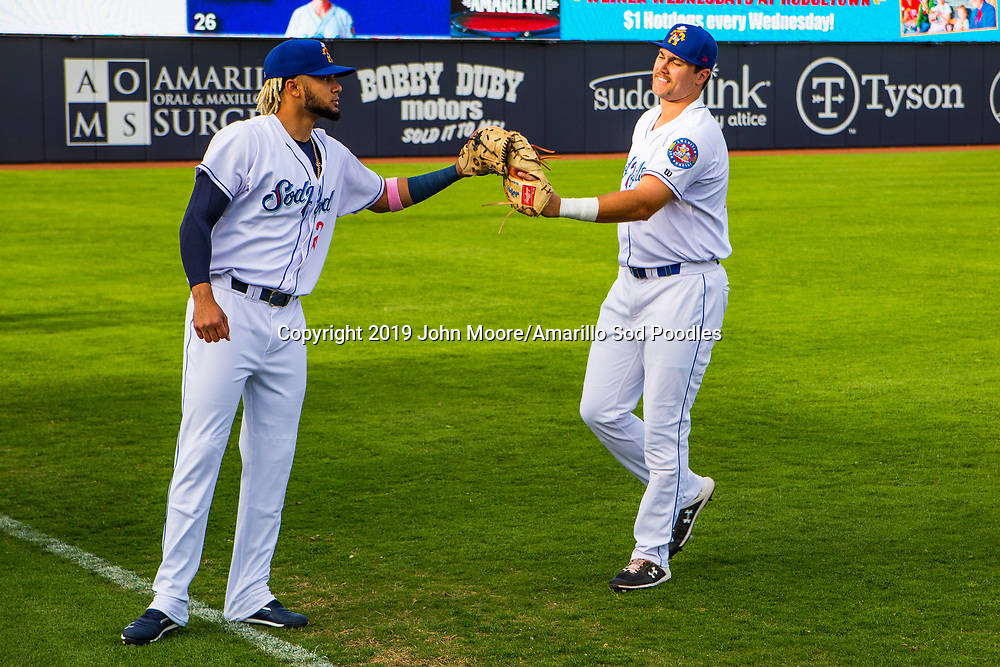 Amarillo Sod Poodles infielder Fernando Tatis Jr. (23) greets Brad Zunica (41) before the game against the Frisco RoughRiders on Tuesday, June 4, 2019, at HODGETOWN in Amarillo, Texas. [Photo by John Moore/Amarillo Sod Poodles]