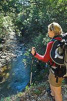Backpacker looks down at Big Sur River, Pine Ridge Trail, Big Sur, California.