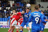 Peterborough United midfielder Mark O'Hara (8) wins this midfield header during the EFL Sky Bet League 1 match between Peterborough United and Barnsley at The Abax Stadium, Peterborough, England on 6 October 2018.