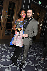 TOLULA ADEYEMI and JACK GUINNESS at a party hosted by Vauxhall Motors to celebrate their collaboration with menswear designer James Small following his Autumn/Winter 2012 show during London Fashion Week held at Corinthia Hotel, London on 22nd February 2012.