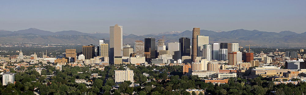 SHOT 7/1/09 6:20:50 AM - Aerial panoramic view of the downtown Denver, Co. skyline and the foothills surrounding Denver from the penthouse at The Pinnacle at City Park South. The City and County of Denver is the capital and the most populous city of the U.S. state of Colorado. The United States Census Bureau estimated that the population of Denver was 598,707 in 2008, making it the 24th most populous U.S. city. Denver City was founded in November 1858 as a mining town during the Pikes Peak Gold Rush in western Kansas Territory..(Photo by Marc Piscotty / © 2009)