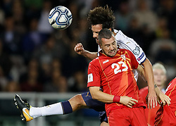 October 6, 2017 - Turin, Italy - Marco Parolo (L) of Italy national team and Ilija Nestorovski of FYR Macedonia national team vie for a header during the 2018 FIFA World Cup Russia qualifier Group G football match between Italy and FYR Macedonia at Stadio Olimpico on October 6, 2017 in Turin, Italy. (Credit Image: © Mike Kireev/NurPhoto via ZUMA Press)