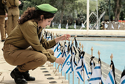 April 16, 2018 - Jerusalem, Israel - IDF soldiers place Israeli flags with black ribbons on each of the graves and salute the fallen at the Mount Herzl Military Cemetery ahead of Memorial Day, Yom Hazikaron, for Israel's fallen servicemen and victims of terror attacks. Memorial day will be marked 18th April, 2018. (Credit Image: © Nir Alon via ZUMA Wire)