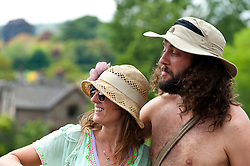 © Licensed to London News Pictures. 29/05/2016. Hay-on-Wye, Powys, Wales, UK. Festival goers and their hats. Beautiful weather on the fourth day of the 'HowTheLightGetsIn' Festival of Ideas at Hay-on-Wye, Wales. Photo credit: Graham M. Lawrence/LNP