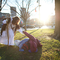 """Michael Grant, 28, """"Philly Jesus,"""" helps a homeless man to his feet in Philadelphia, PA on December 18, 2014.  Nearly everyday for the last 8 months, Grant has dressed as Jesus Christ, and walked the streets of Philadelphia to share the Christian gospel by example.  He quickly acquired the nickname of """"Philly Jesus,"""" which he has gone by ever since."""