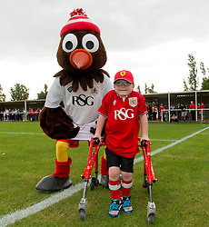 Oskar Pycroft with Bristol City mascot Scrumpy -  Photo mandatory by-line: Dougie Allward/JMP - Mobile: 07966 386802 - 05/07/2015 - SPORT - Football - Bristol - Brislington Stadium - Pre-Season Friendly