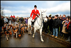 Members of the public watch members of the The Essex Hunt turn out for the Traditional Boxing Day Hunt in Matching Green, Essex.United Kingdom. Thursday, 26th December 2013. Picture by Andrew Parsons / i-Images