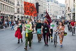 London, UK. 18th April 2019. Climate change activists from Extinction Rebellion in Regent Street take part in the fourth day of the International Rebellion to call on the British government to take urgent action to combat climate change.