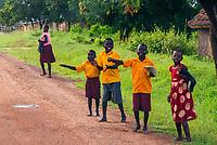 Passing school children on the road in Uganda.