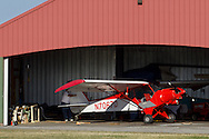 Middletown, New York - A pilot pulls his plane into place in a hangar at Randall Airport on  April 12, 2014.