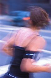 one female jogger crossing city street CITY URBAN STOCK PHOTO CONCEPT STOCK PHOTOS
