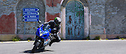 Motorcyclist on Suzuki R GSX motorbikes drives The Stelvio Pass, Passo dello Stelvio, Stilfser Joch to Bormio, Italy