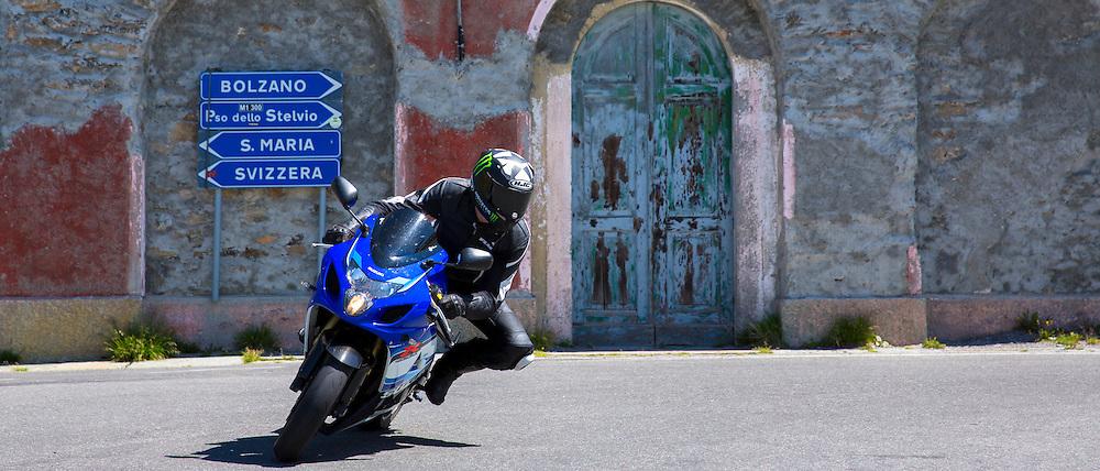 Motorcyclist on Suzuki R GSX motorbikes drives The Stelvio Pass, Passo dello Stelvio, Stilfser Joch to Bormio, Italy