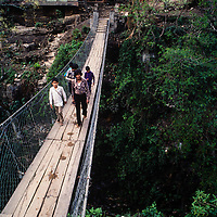 Villagers in the Marsyandi Valley cross a high suspension bridge east of Annapurna in Nepal.