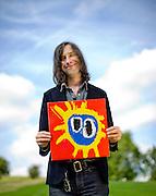 Bobby Gillespie of Primal Scream pictured with original album cover.