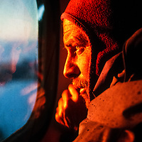 Mike Sharp looks out window of Twin Otter in Queen Maud Land, Antarctica.