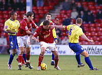 Photo: Dave Linney.<br />Walsall v Colchester United. Coca Cola League 1.<br />14/01/2006.<br />No way through for Walsall's Grant Smith (C) as Kevin Watson stops his run.<br />.