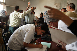 Alyaa Abdul Hassan Abbood, 23, a translator,  mediates as Iraqi civilians get monetary compensation for damages done by U.S. troops at a court in Baghdad, Iraq, Sept. 27, 2003.