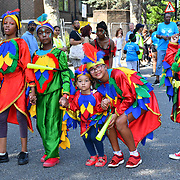 London, UK. 25th Aug 2019. Thousands attend the first day of the Notting Hill Carnival in west London on August 25, 2019. Nearly one million people are expected by the organizers regradless of the wet weather Sunday and Monday in the streets of west London's Notting Hill to celebrate Caribbean culture at a carnival considered the largest street demonstration in Europe, London, UK.