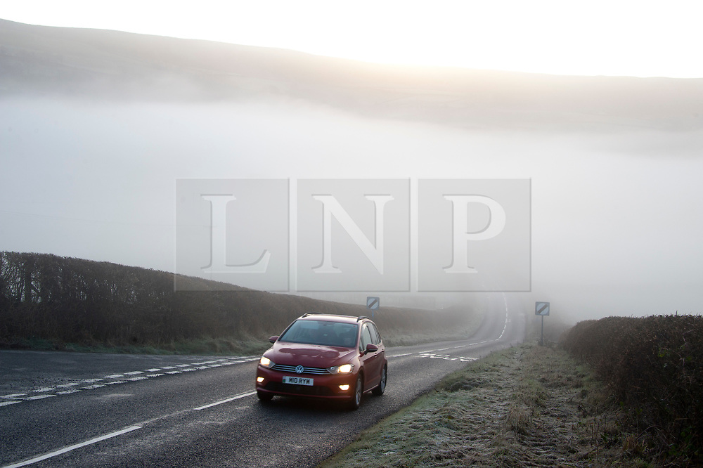 © Licensed to London News Pictures. 18/01/2020. Builth Wells, Powys, Wales, UK. A motorist drives through a foggy frosty valley near Builth Wells in Powys, Wales, after temperatures dropped to below freezing last night. Photo credit: Graham M. Lawrence/LNP