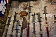 Medieval pike weapons at Comlongon Castle, a restored Medieval Scottish tower house dating from the late 1400s. Guests can stay in the attached Edwardian hotel, a baronial style mansion built 1900-02, set in 120 acres of manicured gardens, sweeping lawns, carp pond, lakes and woodlands, near Clarencefield and Dumfries, in southwest Scotland, United Kingdom, Europe. Originally built by the Murrays of Cockpool, Comlongon Castle remained in the Murray family until 1984. The castle is 50 feet square and stands 70 feet high, with walls over 4 meters thick, with impressive displays of weapons, armor and banners.