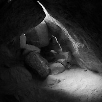 Looking for another passage in slot canyon, yet finding this path blocked - and spotlighted by nature for effect.