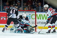 KELOWNA, BC - JANUARY 4: Roman Basran #30 of the Kelowna Rockets makes a save on a shot by Alex Kannok Leipert #41 of the Vancouver Giants  at Prospera Place on January 4, 2020 in Kelowna, Canada. (Photo by Marissa Baecker/Shoot the Breeze)