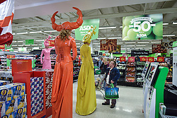 Jo Peacock and her cheeky cohorts dressed as Candy Coloured stiltwalkers wander around the interior of an ASDA store in South Woodham Ferrers.