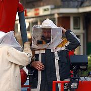 Brandweer verwijderend bijen nest raadhuisstraat Huizen