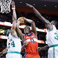 07 April 2013: Boston Celtics power forward Chris Wilcox (44) and Boston Celtics power forward Brandon Bass (30) defend on Washington Wizards power forward Kevin Seraphin (13) during the Boston Celtics 107-96 victory over the Washington Wizards at the TD Garden, Boston, Massachusetts, USA.