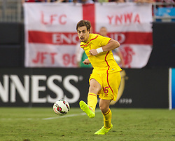 CHARLOTTE, USA - Saturday, August 2, 2014: Liverpool's Sebastian Coates in action against AC Milan during the International Champions Cup Group B match at the Bank of America Stadium on day thirteen of the club's USA Tour. (Pic by Mark Davison/Propaganda)