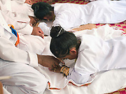 Muslim Cham girls wearing white dresses and bronze and copper jewellery receive blessings from the priests at a Karoh (maturity) ceremony in Van Lam, Ninh Thuan province, Central Vietnam. Cham girls usually in groups of around 5, undergo a Karoh (maturity) ceremony, one of the most important ritual events of their lives and if it has not taken place, the girl cannot marry. The Cham, a Muslim community of around 39,000 people living along the coast of Central Vietnam are one of the 54 ethnic groups recognised by the Vietnamese government.