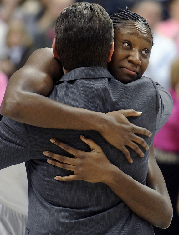 Connecticut's Tina Charles hugs head coach Geno Auriemma as she looks up at her banner, which was added to the UConn 'Huskies of Honor' before the NCAA college basketball game against St. John's  in Storrs, Conn., Saturday, Feb. 13, 2010.  (AP Photo/Jessica Hill)