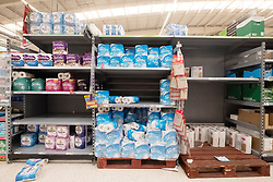 © Licensed to London News Pictures. 21/09/2020. London, UK. Virtually empty shelves of toilet paper at an Asda supermarket in Wembley. Some shoppers have been reported to start panic buying items including toilet paper and household good ahead of a feared second wave of Covid-19. Photo credit: London News Pictures