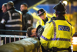 """© Licensed to London News Pictures . 15/11/2015 . Manchester , UK . Police detain a man outside the event . Annual student pub crawl """" Carnage """" at Manchester's Deansgate Locks nightclubs venue . The event sees students visit several clubs over the course of an evening . This year's theme is """" Animal Instinct - unleash your beast """" . Photo credit : Joel Goodman/LNP"""