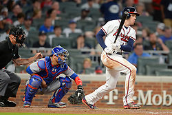 May 15, 2018 - Atlanta, GA, U.S. - ATLANTA, GA Ð MAY 15:  Braves first baseman Freddie Freeman (5) hits a ground ball during the game between Atlanta and Chicago on May 15th, 2018 at SunTrust Park in Atlanta, GA. The Chicago Cubs defeated the Atlanta Braves by a score of 3 -2.  (Photo by Rich von Biberstein/Icon Sportswire) (Credit Image: © Rich Von Biberstein/Icon SMI via ZUMA Press)