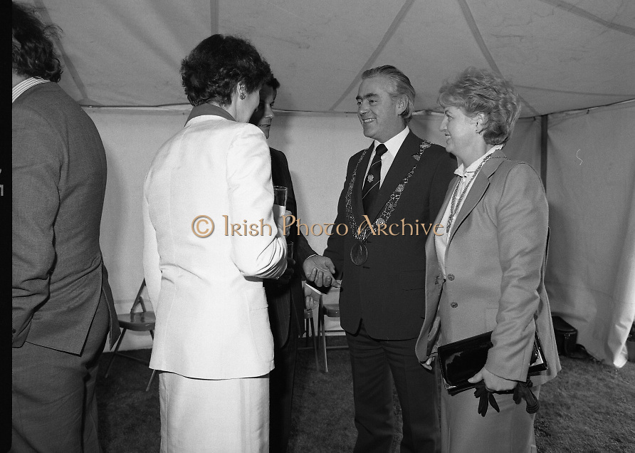 Guests and staff at the US Embassy in Phoenix Park, Dublin, celebrate American Independence Day..1980-07-04.4th July 1980.04/07/1980.07-04-80..Photographed at the US Ambassador's Residence,  Phoenix Park...Mayor of Dublin, Fergus O'Brien and his wife chat with Elizabeth McNelly Shannon (back to camera) in marquee during festivities.