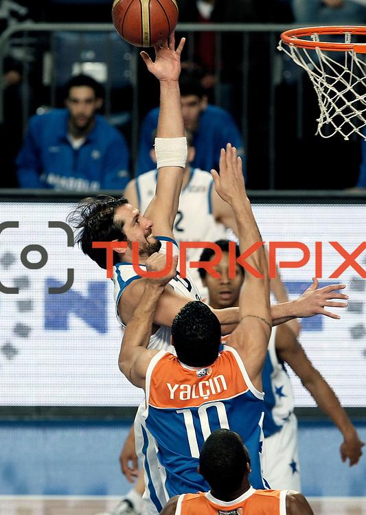 Anadolu Efes's Kerem Tunceri (C) during their Turkish Basketball League match Anadolu Efes between Mersin BSB at Sinan Erdem Arena in Istanbul, Turkey, Saturday, January 14, 2012. Photo by TURKPIX