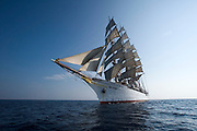 Passengers get a view of the Sea Cloud under full sails from aboard the zodiacs.
