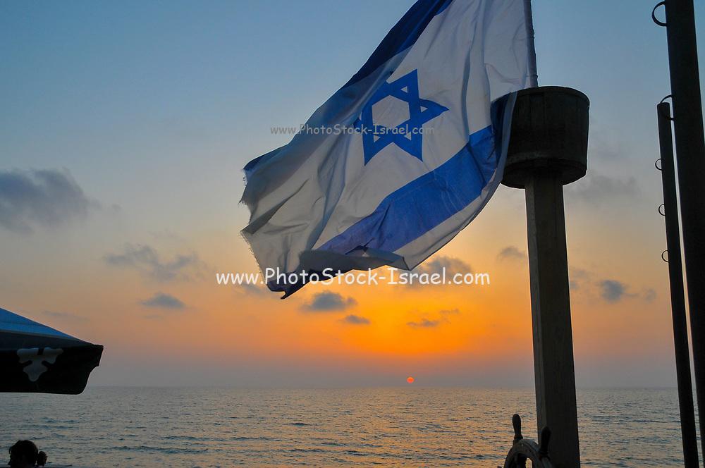 Israeli Flag blue sky at sunset