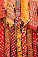 Colorful Moroccan Rugs for sale on the streets of the old Medina, Fes el Bali, Fes, Morocco