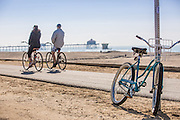 Couple Riding Bikes Along the Huntington Beach Bike Path