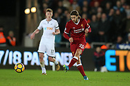 Adam Lallana of Liverpool in action. Premier league match, Swansea city v Liverpool at the Liberty Stadium in Swansea, South Wales on Monday 22nd January 2018. <br /> pic by  Andrew Orchard, Andrew Orchard sports photography.