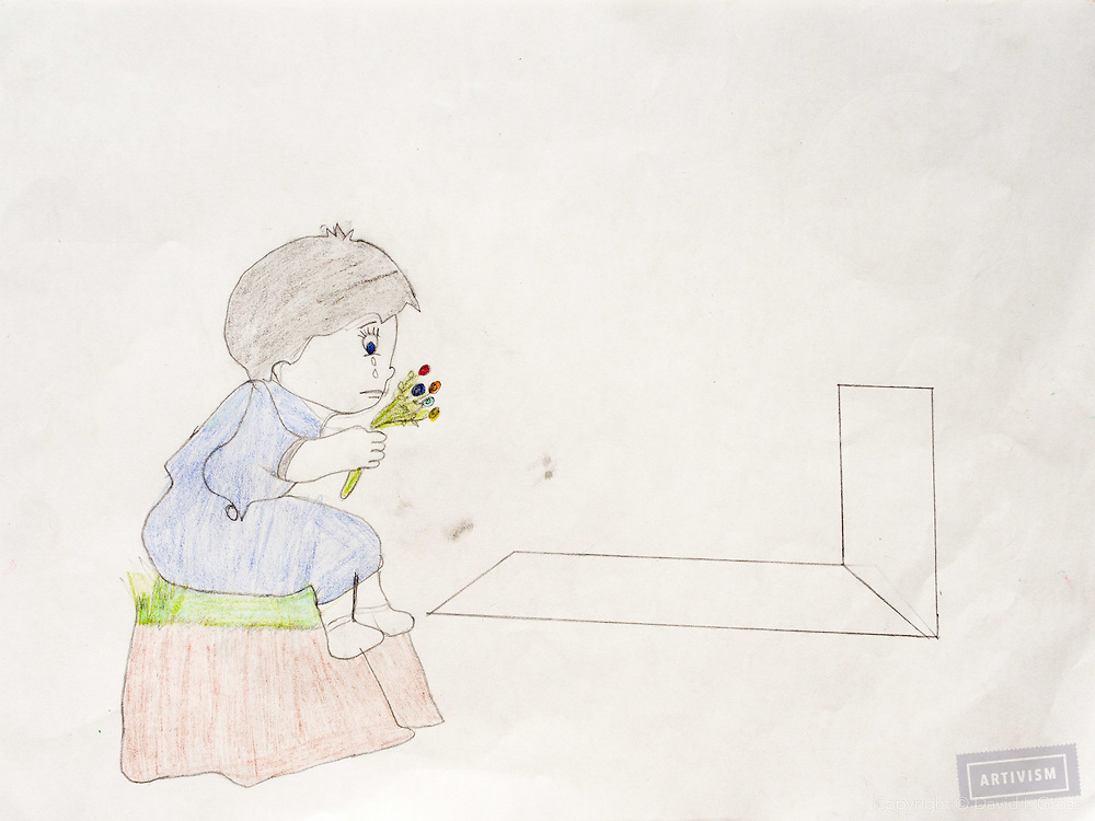 """""""A girl at her father's grave."""" Drawing by Syrian girl, age 13. (Topic for this session: dealing with loss.)"""