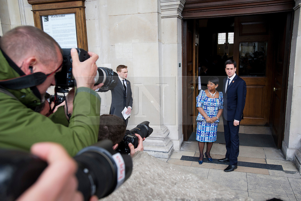 © London News Pictures. 22/04/2013. London, UK.  Labour part leader ED MILIBAND being greeted by DOREEN LAWRENCE, Mother of Stephen Lawrence as he arrives at a memorial service at St Martins in the Field Church in London marking the 20 anniversary of the murder of Stephen Lawrence. Stephen Lawrence was murdered in a racist attack while waiting for a bus in SOuth London on the evening of 22 April 1993. Photo credit : Ben Cawthra/LNP