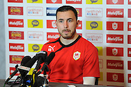 Cardiff city player Jordon Mutch speaks at the Cardiff city FC press conference, Barclays Premier league pre Everton match press conf at the Vale resort Hotel in Hensol,  near Cardiff , South Wales on Friday 14th March 2014. pic by Andrew Orchard, Andrew Orchard sports photography