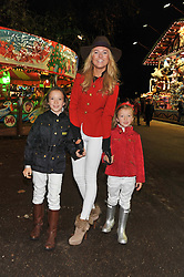 KIMBERLY GARNER and her nieces left HAYLEY DE PELET and SCARLETT DE PELET at the opening of the 2012 Winter Wonderland, Hyde Park on 22nd November 2012.