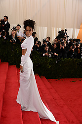 Rihanna attends the 2014 Metropolitan Museum of Art's Costume Institute Benefit Gala celebrating the opening of the exhibition 'Charles James: Beyond Fashion' and the new Anna Wintour Costume Center, in New York City, NY, USA on May 5, 2014. She is wearing a shirt and skirt by Stella McCartney. Photo by Briquet-Douliery/ABACAPRESS.COM  | 446025_844 New York City Etats-Unis United States