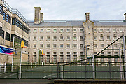 The main exercise yard of between wings at HMP/YOI Portland, a resettlement prison with a capacity for 530 prisoners. Dorset, United Kingdom.